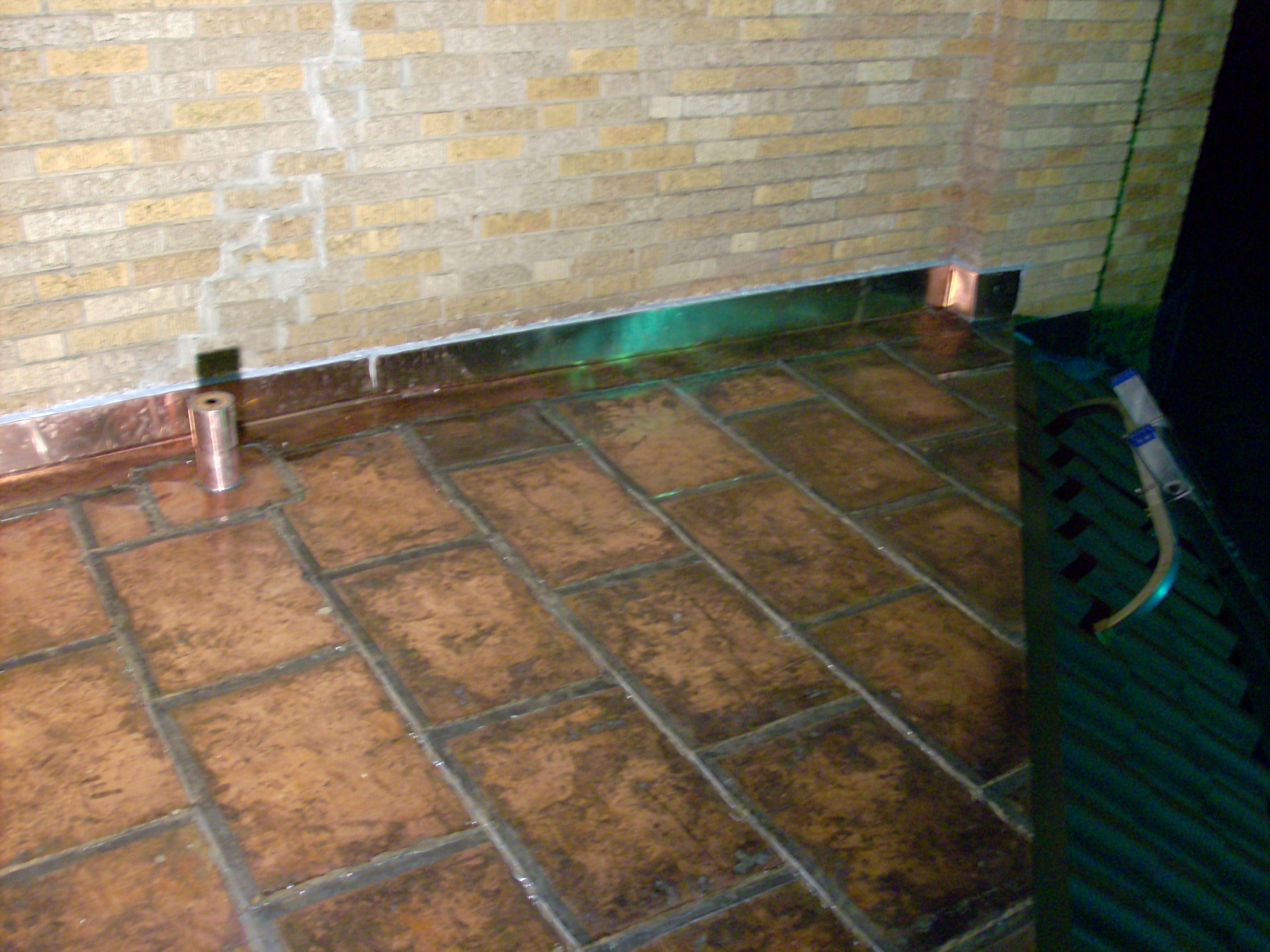 Copper flat lock roof with small custom copper soil pipe.