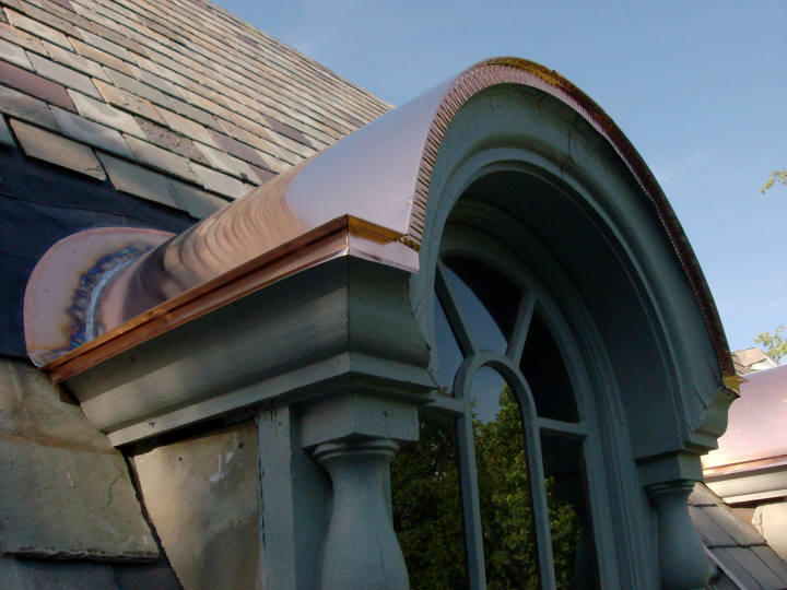 Copper barrel dormer flat seam roof - front view.