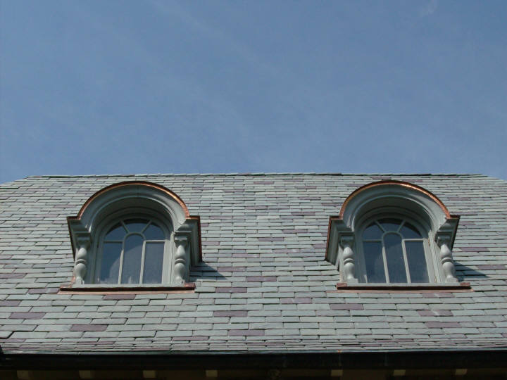Copper barrel dormer flat seam roofs - ground view.