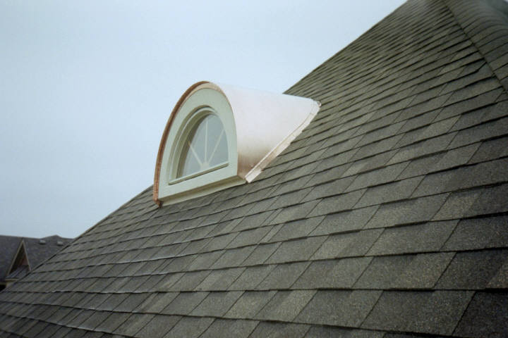 Copper barrel dormer roof with window.