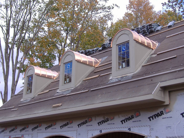 Copper barrel dormer standing seam roof, 180 degree radius.