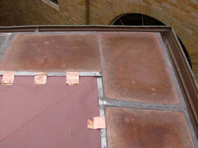Copper flat lock roof fastening detail.
