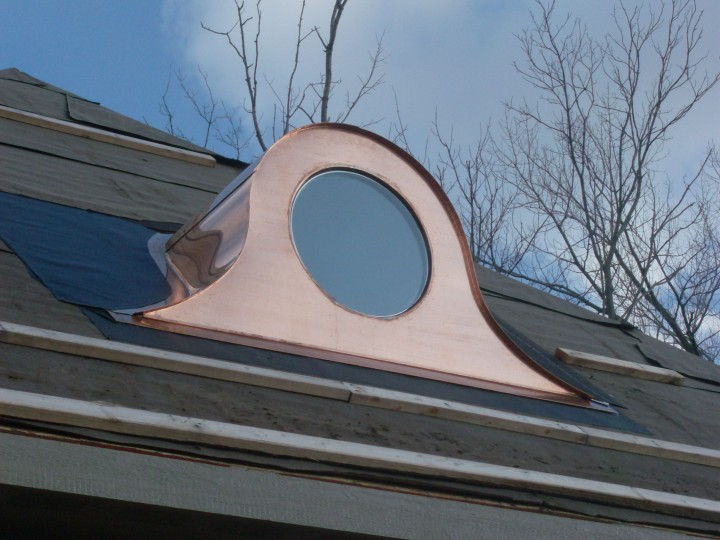 Custom copper eyebrow window dormer.